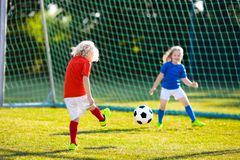 Kids play football. Child at soccer field royalty free stock image
