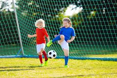 Kids play football. Child at soccer field royalty free stock photo