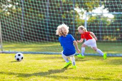 Kids play football. Child at soccer field stock image