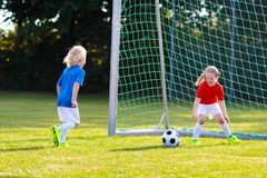 Kids play football. Child at soccer field stock photo