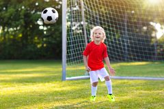 Kids play football. Child at soccer field royalty free stock images