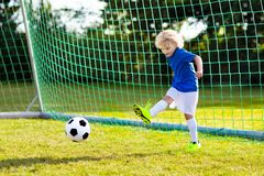 Kids play football. Child at soccer field royalty free stock photos