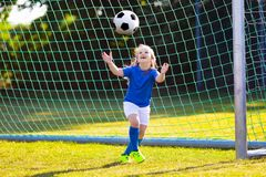 Kids play football. Child at soccer field. Stock Images