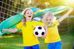 Brazil football fan kids. Children play soccer. stock photos