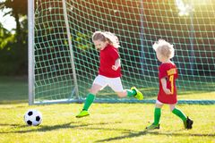 Portugal football fan kids. Children play soccer. royalty free stock photo