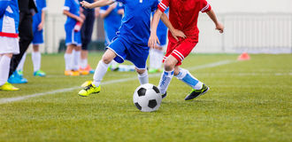 Kids play football on the soccer pitch Royalty Free Stock Photography
