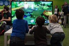 Kids play at Games Week 2013 in Milan, Italy stock photo