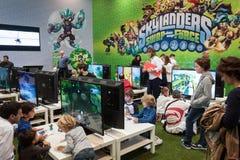 Kids play at Games Week 2013 in Milan, Italy Royalty Free Stock Image