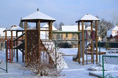 Kids play ground in winter Royalty Free Stock Image