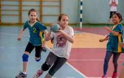 Kids play handball indoor. Sports and physical activity. Training and sports for children royalty free stock photo