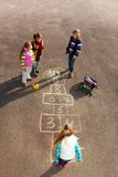 Kids play hopscotch royalty free stock image