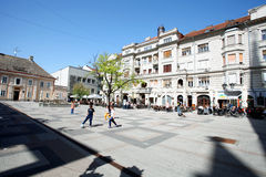 Kids play in Katolicka Porta in Novi Sad. In the centre of Novi Sad - back yard. Streets with old houses of the old town royalty free stock photos