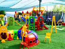 Kids Play Area. A kids Play land filled with colorful play equipment on an artificial grass carpet royalty free stock photos