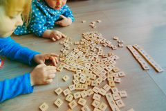 Kids play with letter puzzle in school or daycare Royalty Free Stock Photography