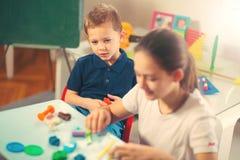 Kids Play Modeling Plasticine Stock Image