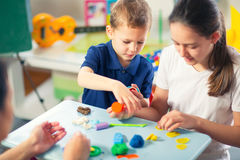 Kids Play Modeling Plasticine. In the living room Royalty Free Stock Photo