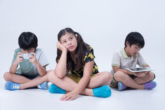 Kids play phone. Kids playing smart phone girl bored online different asian emotion social boy preoccupied Stock Photo