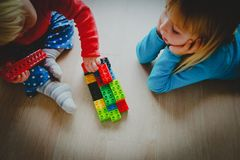 Kids play with plastic blocks, learning concept. Little girls play with plastic blocks, learning concept royalty free stock image