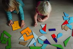 Kids play with puzzle, learn math, education concept. Kids playing with puzzle, education and learning concept royalty free stock photos