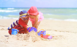 Kids play with sand on summer beach. Family vacation Royalty Free Stock Image