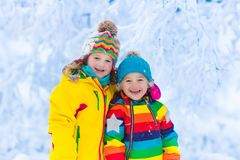Kids play with snow in winter park Royalty Free Stock Images