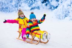 Kids play in snow. Winter sleigh ride for children Stock Photography