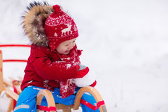 Kids play in snow. Winter sleigh ride for children Stock Photo