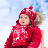 Kids play in snow. Winter sleigh ride for children Stock Photos
