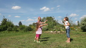 Kids play with soap bubbles outdoor Royalty Free Stock Images