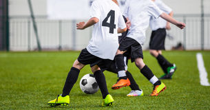 Kids play soccer football game Royalty Free Stock Image