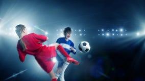 Kids play soccer on stadium Stock Photos
