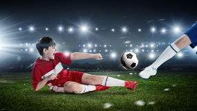 Kids play soccer on stadium Royalty Free Stock Image