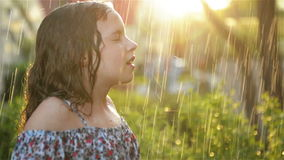 Kids Play in Summer Rain. Child Playing Outdoor On Rainy Day. Little Girl Catching Rain Drops Under Heavy Shower. Fall stock footage