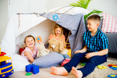 Kids in a play tent. Portrait of three kids in a play tent royalty free stock photo