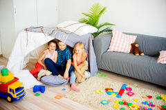 Kids in a play tent. Portrait of three kids in a play tent stock photography