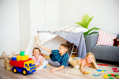 Kids in a play tent. Portrait of three kids in a play tent stock photos