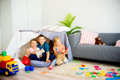 Kids in a play tent. Portrait of three kids in a play tent royalty free stock images