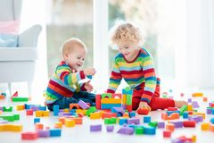 Kids play with toy blocks. Toys for children. Royalty Free Stock Photography
