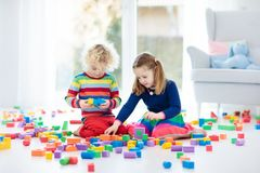 Kids play with toy blocks. Toys for children. Stock Photo