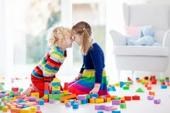 Kids play with toy blocks. Toys for children. Royalty Free Stock Photos