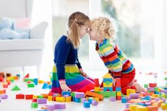 Kids play with toy blocks. Toys for children. Stock Image