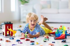 Kids play with toy cars. Children playing car toys stock photos