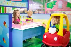 Kids play at toy supermarket or grocery store. Child playing in toy shop or restaurant. Educational toys and role game for kids. Kindergarten or preschool play Royalty Free Stock Photos