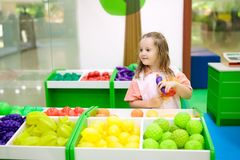 Kids play at toy supermarket or grocery store. Stock Image