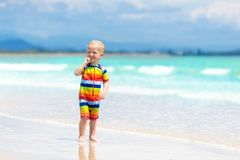 Kids play on tropical beach. Sand and water toy. Stock Photo