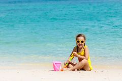Kids play on tropical beach. Sand and water toy royalty free stock photography