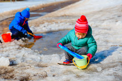 Kids play in winter snow Stock Photo