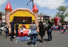 Kids play zone during Bay Fest street festival on Sheepshead Bay in Brooklyn. BROOKLYN, NEW YORK - MAY 20, 2018: Kids play zone during Bay Fest street festival royalty free stock photo