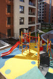 Kids playground. Blocks of flats with kids playground Royalty Free Stock Image