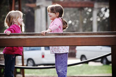 Kids in playground. Two cute little girls playing together at the playground royalty free stock photo